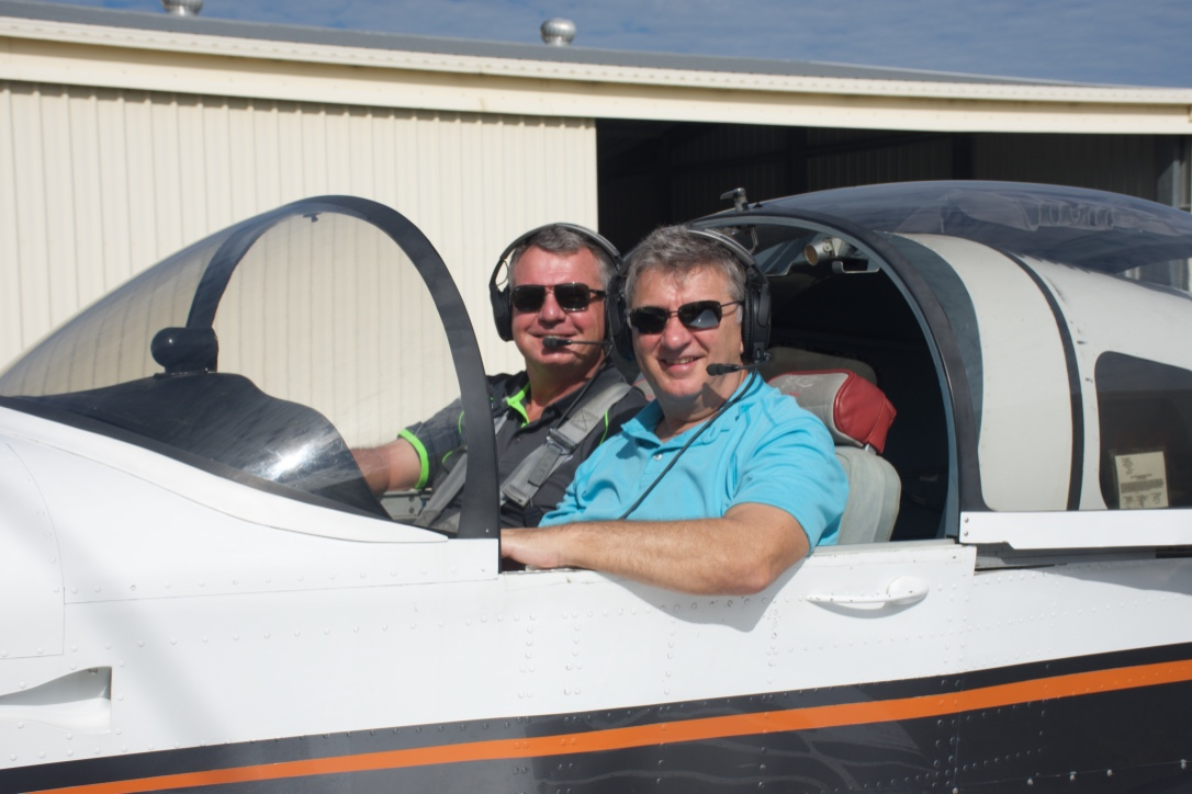Student and Instructor returning from an enjoyable flight lesson Gold Coast Sports Flight Training Heck Field Jacobs Well