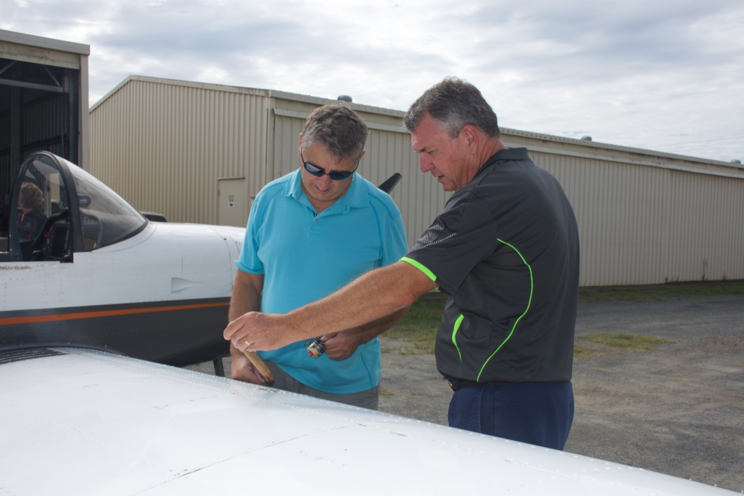 Student and Instructor checking fuel before a flight lesson Gold Coast Sports Flight Training Heck Field Jacobs Wellle flight lesson Gold Coast Sports Flight Training Heck Field Jacobs Well